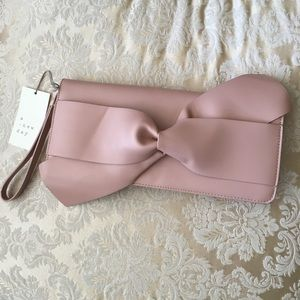 New pink bow clutch